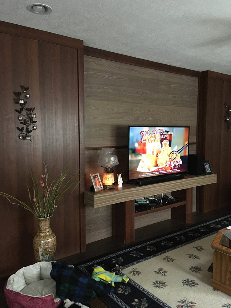 wood wall with mounted tv stand