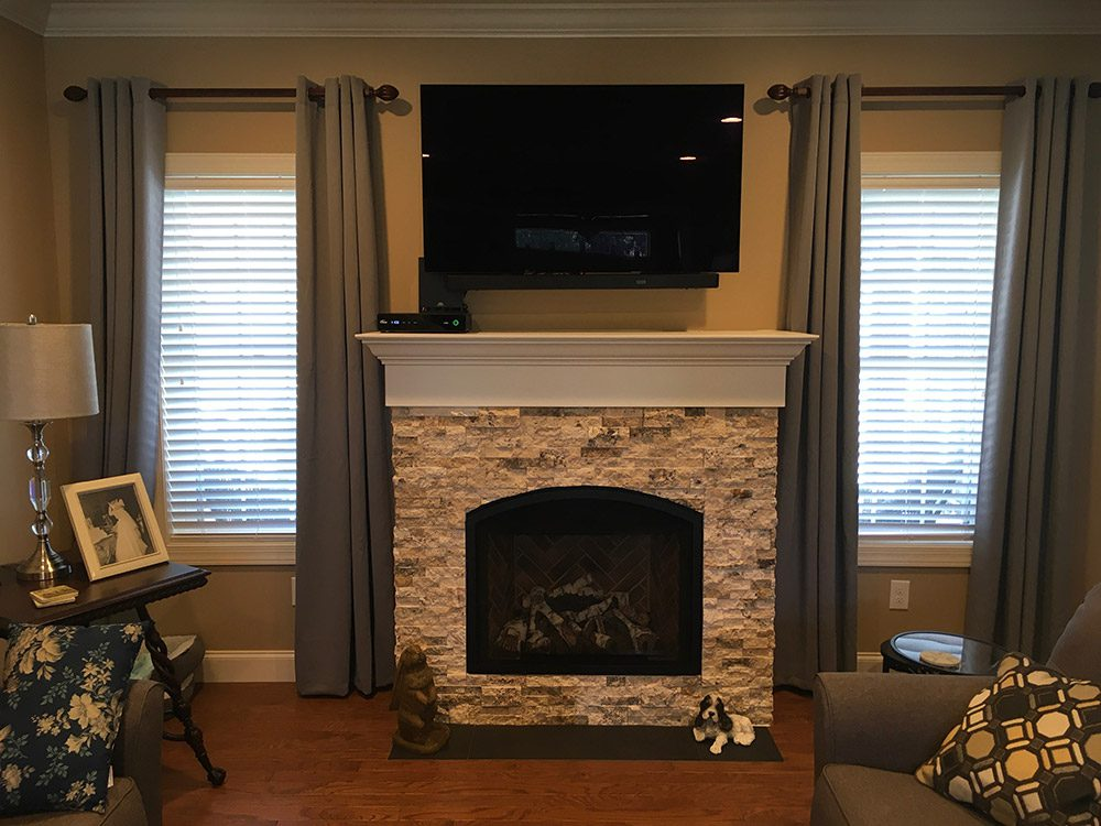 finished living room with fireplace