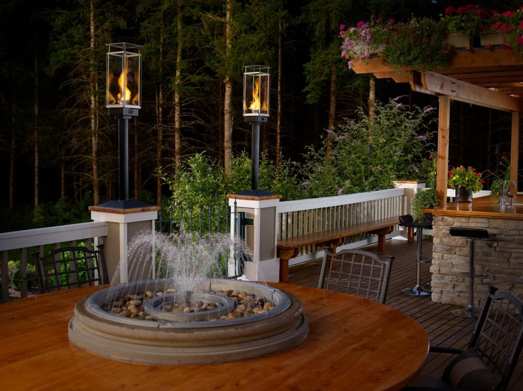lighting poles on patio around tabletop fountain