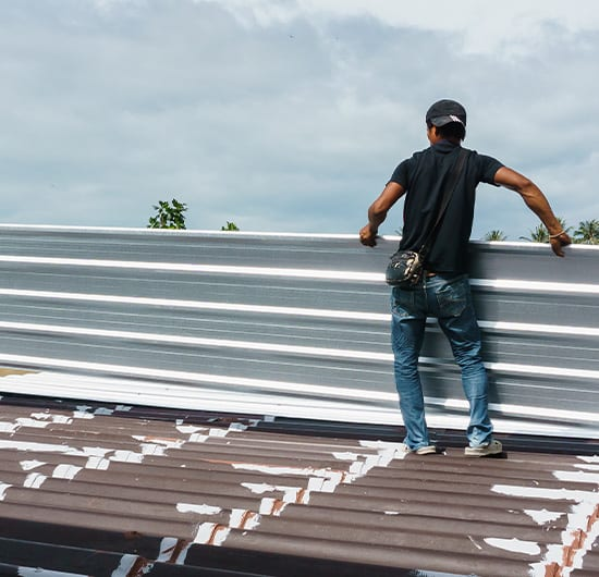 setting up panels on top of roof, roof maintenance