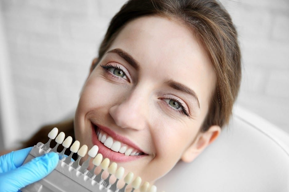 Patient considering tooth whitening at cosmetic dental appointment