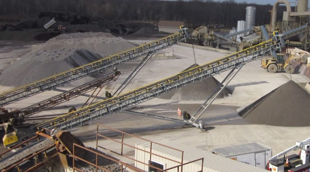 Conveyor belts with stone piles