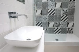 geometric pattern shower curtain and sink