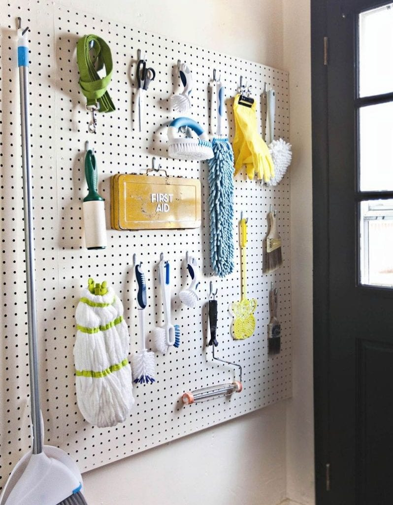 pegboard with cleaning supplies