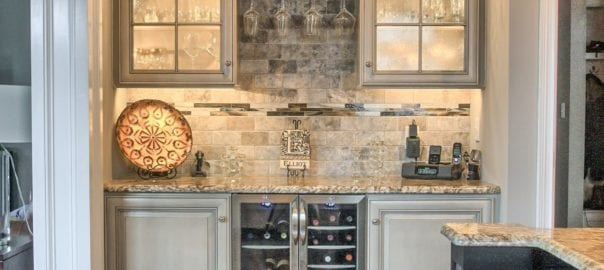 Glasses cleverly organized in kitchen beverage center by Red Rose Cabinetry