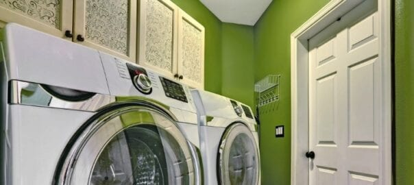 Smaller laundry room with minimal clutter thanks to custom cabinetry