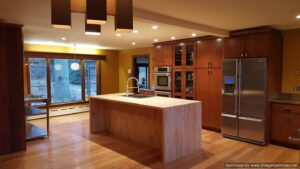 A kitchen with a wooden island.