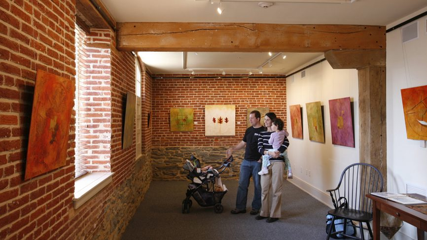 family looking at art in gallery