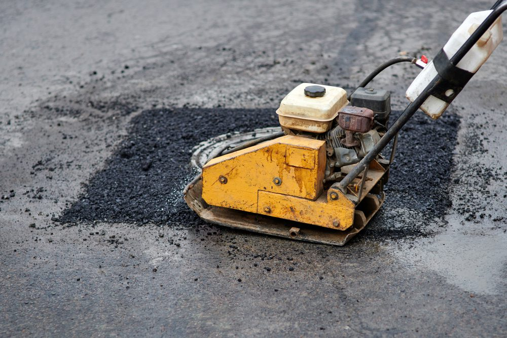 Can Insurance Help Cover Asphalt Paving Repair for Your Business' Driveway?
