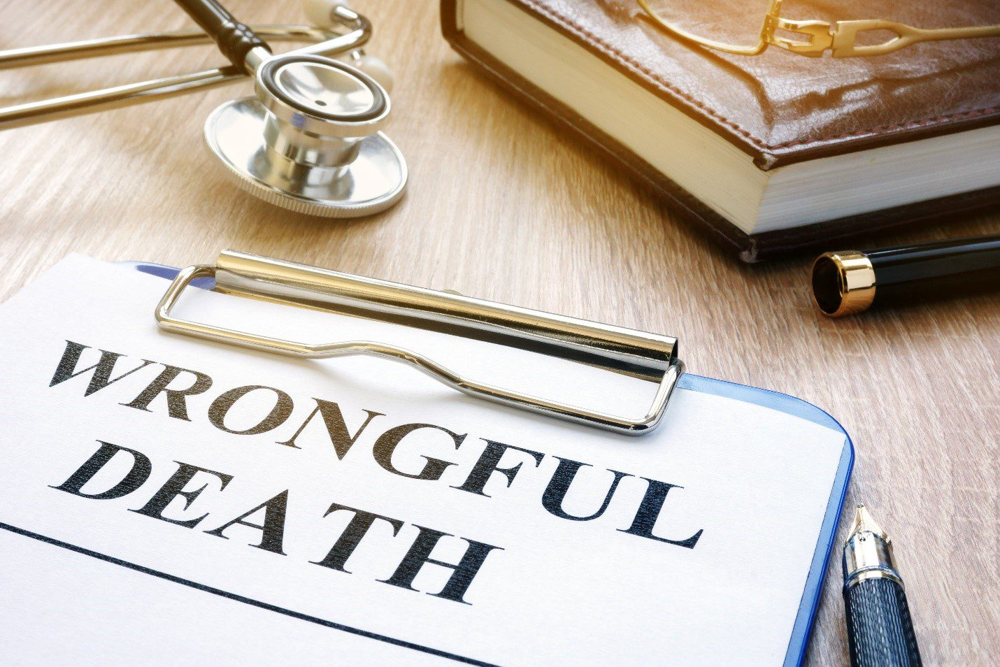 Wrongful death concept image with stethoscope and law book