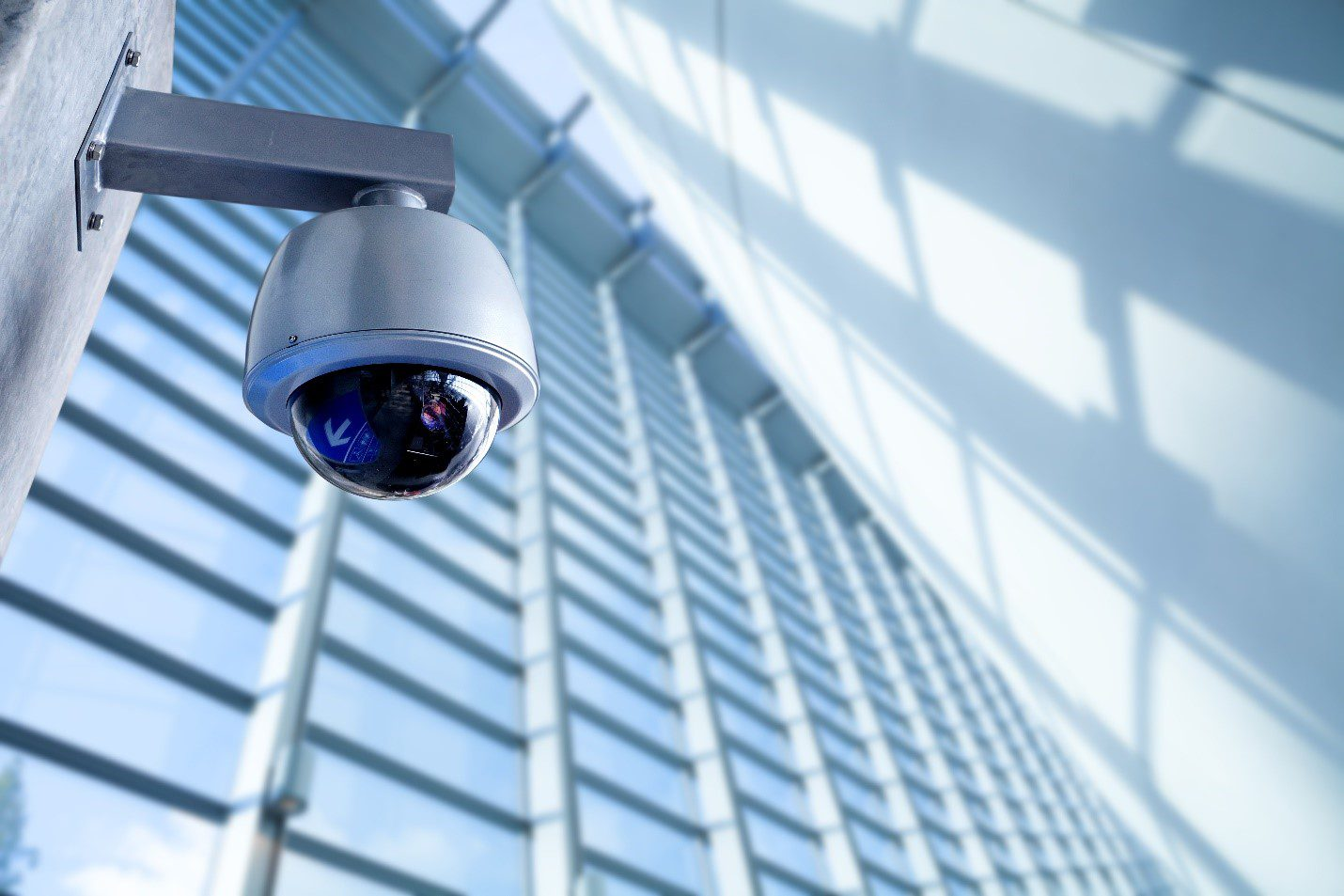 Surveillance camera on the wall in an office building