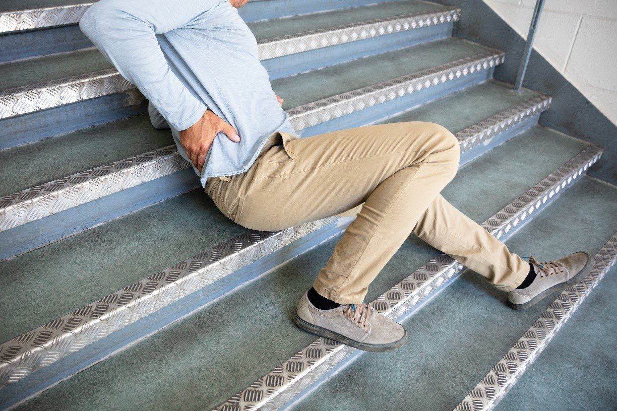 man after falling on steps