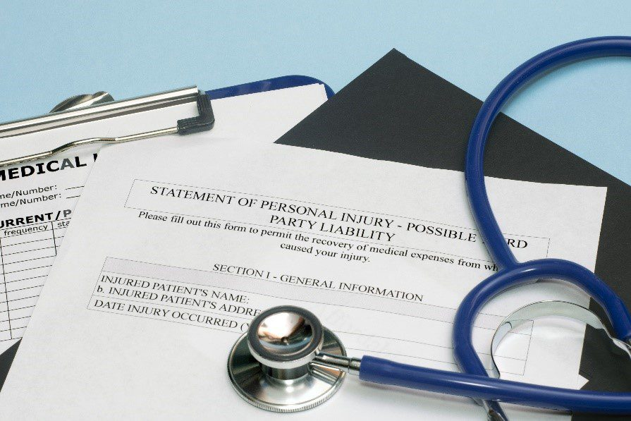 Personal injury claim forms with a stethoscope