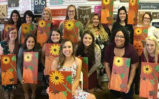 group of ladies with sunflower painting craft