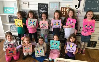 group of kids with unicorn craft painting