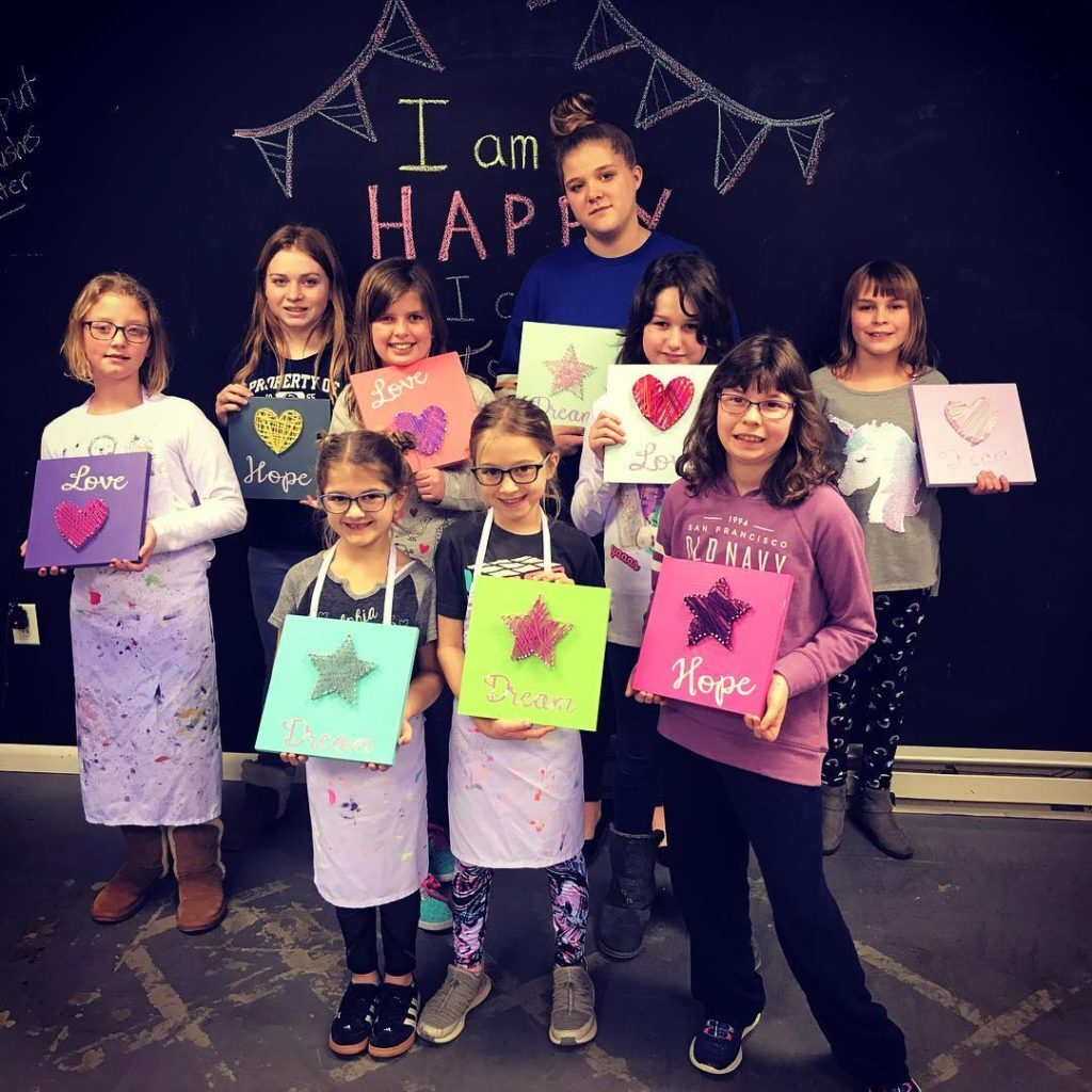 group od kids with their string art craft project